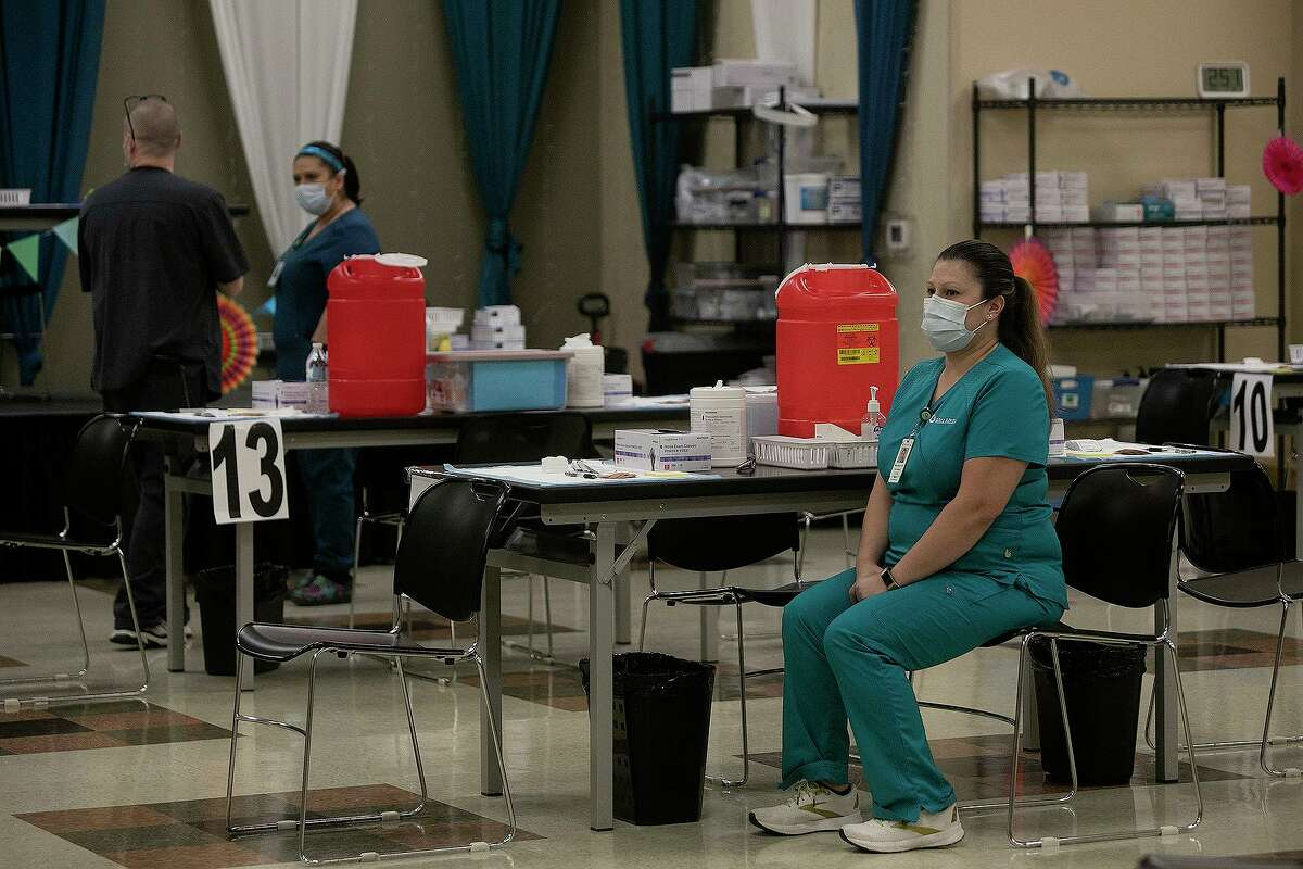 After an initial rush at 1 p.m. when the shot became available again, LVN Melissa Reyes waits for people to arrive to receive their Johnson & Johnson COVID-19 vaccine Wednesday, April 28, 2021, at WellMed's vaccine clinic at Treviño López Senior One-Stop Center.