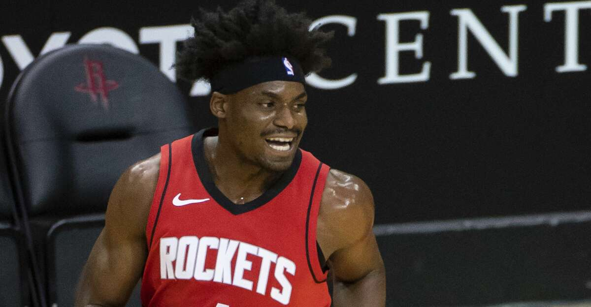 Houston Rockets forward Danuel House Jr. (4) reacts after hitting a three point shot during the first quarter of an NBA game between the Houston Rockets and Minnesota Timberwolves on Tuesday, April 27, 2021, at Toyota Center in Houston.