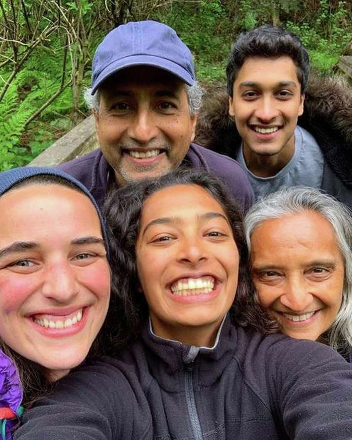 Clockwise from bottom center, Sana Javeri Kadri and her partner Rosie Russell with Kadri's father Rahul, brother Aman Javeri Kadri and mother Shimul Javeri in Mumbai, India in March 2020. Sana Javeri Kadri, CEO of the Oakland-based spice company Diaspora Co., is calling for increased public awareness and financial support for India during its devastating second wave in the COVID-19 crisis.