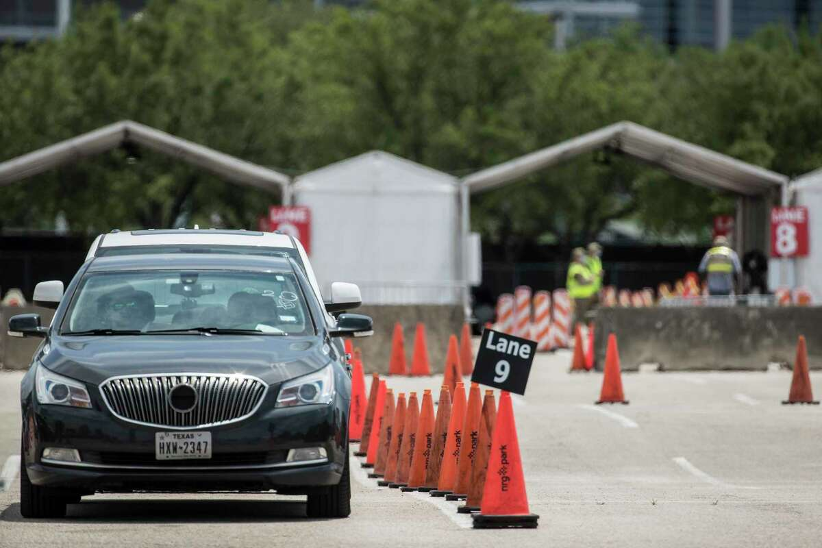 A few cars are lined up in the post-vaccination waiting area at the FEMA COVID-19 Community Vaccination Center at NRG Park at NRG Park Monday, April 26, 2021 in Houston. Two months ago, lines for COVID-19 vaccines wrapped around clinic sites. Those who could take off a morning or afternoon mid-week drove across county lines for a first dose. Workers rushed to retail pharmacies in hopes of catching extra doses at the end of the day. These days, hospitals and public health sites are desperate to fill up their vaccine schedules. Where there were once hours-long waits, there are now walk-in appointments.