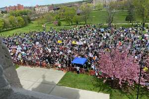 Thousands gather on north side of the State Capitol in opposition to bill that would repeal the so-called religious exemption from mandatory childhood vaccinations on Tuesday, April 27, 2021.