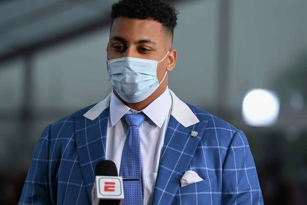 Northwestern tackle Rashawn Slater appears on the Red Carpet at the Rock & Roll Hall of Fame before the first round of the 2021 NFL football draft, Thursday, April 29, 2021, in Cleveland. (AP Photo/David Dermer, Pool)