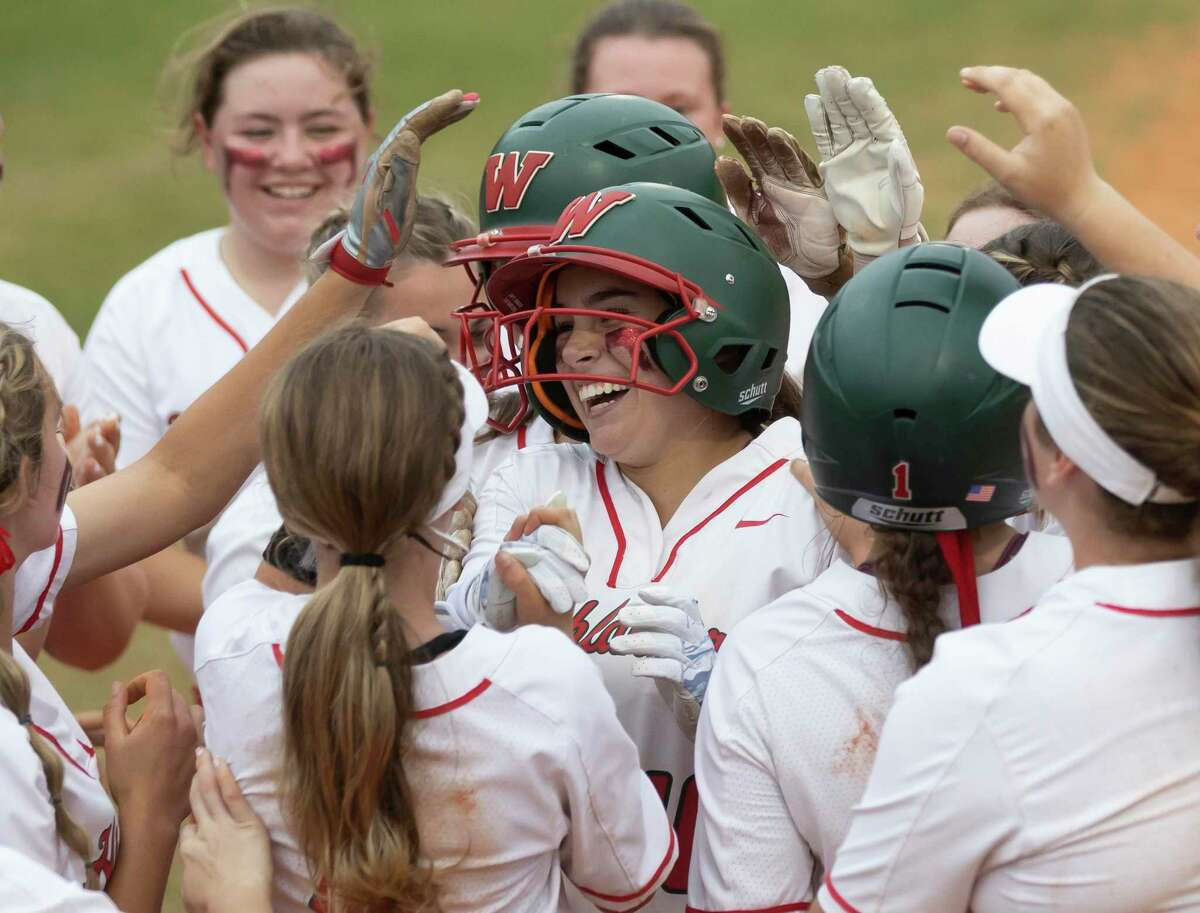 Gabby Leach #10 of The Woodlands reacts as she's embraced by her teammates after hitting a home run during the second inning of a Region II-6A bi-district playoff game at The Woodlands High School, Thursday, April 29, 2021, in The Woodlands.
