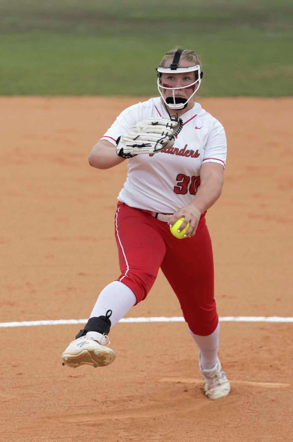 The Woodlands pitcher Saylor Davis (30) pitches the ball during the first inning of a Region II-6A bi-district playoff game against Dekaney at The Woodlands High School, Thursday, April 29, 2021, in The Woodlands.