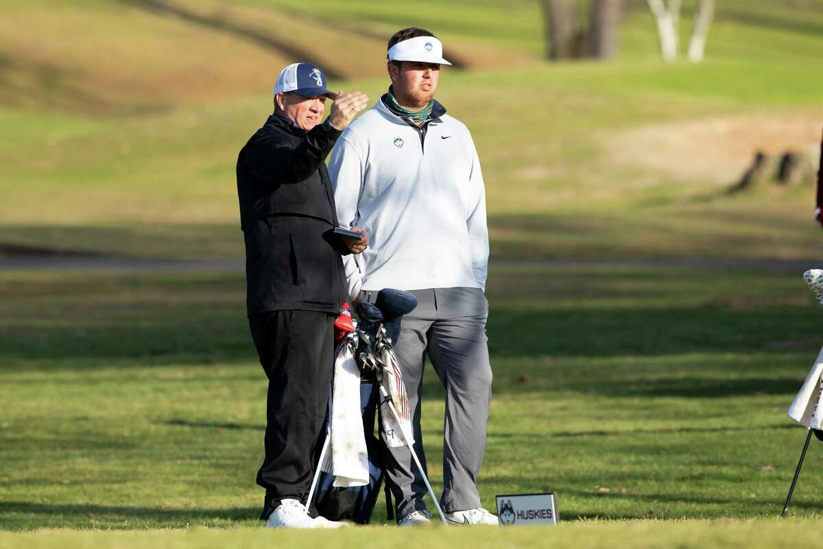 UConn men's golf coach Dave Pezzino and Jared Nelson.