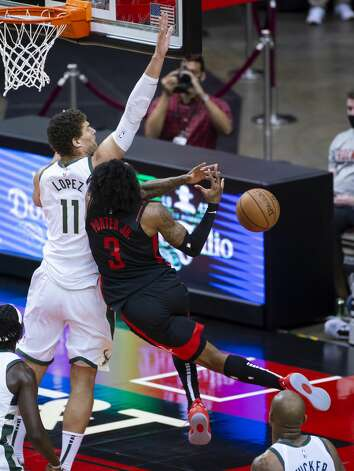 Houston Rockets guard Kevin Porter Jr. (3) is fouled by Milwaukee Bucks center Brook Lopez (11) during the third quarter of an NBA game between the Houston Rockets and Milwaukee Bucks on Thursday, April 29, 2021, at Toyota Center in Houston. Photo: Mark Mulligan/Staff Photographer / © 2021 Mark Mulligan / Houston Chronicle
