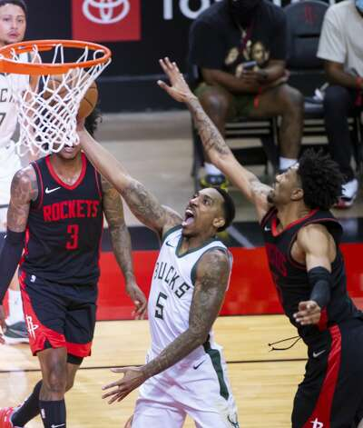 Milwaukee Bucks guard Jeff Teague (5) shoots around Houston Rockets center Christian Wood (35) during the third quarter of an NBA game between the Houston Rockets and Milwaukee Bucks on Thursday, April 29, 2021, at Toyota Center in Houston. Photo: Mark Mulligan/Staff Photographer / © 2021 Mark Mulligan / Houston Chronicle
