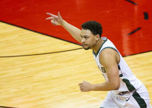 Milwaukee Bucks guard Bryn Forbes (7) celebrates after hitting another 3-point shot during the second quarter of an NBA game between the Houston Rockets and Milwaukee Bucks on Thursday, April 29, 2021, at Toyota Center in Houston. Photo: Mark Mulligan/Staff Photographer / © 2021 Mark Mulligan / Houston Chronicle