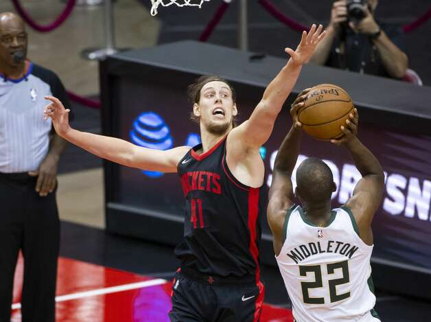 Houston Rockets forward Kelly Olynyk (41) defends Milwaukee Bucks forward Khris Middleton (22) during the second quarter of an NBA game between the Houston Rockets and Milwaukee Bucks on Thursday, April 29, 2021, at Toyota Center in Houston. Photo: Mark Mulligan/Staff Photographer / © 2021 Mark Mulligan / Houston Chronicle