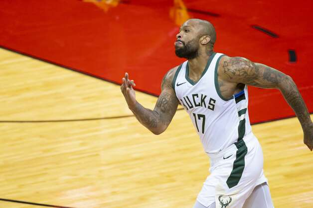Milwaukee Bucks forward P.J. Tucker (17) celebrates after hitting a corner 3-point shot during the first quarter of an NBA game between the Houston Rockets and Milwaukee Bucks on Thursday, April 29, 2021, at Toyota Center in Houston. Photo: Mark Mulligan/Staff Photographer / © 2021 Mark Mulligan / Houston Chronicle