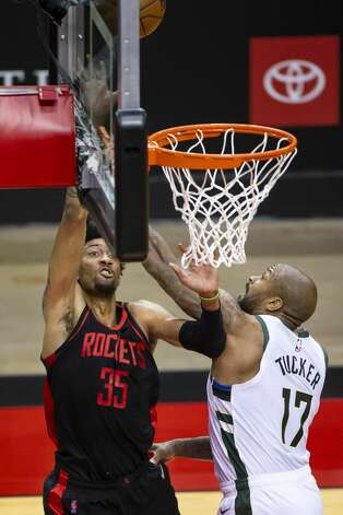Houston Rockets center Christian Wood (35) shoots around Milwaukee Bucks forward P.J. Tucker (17) during the first quarter of an NBA game between the Houston Rockets and Milwaukee Bucks on Thursday, April 29, 2021, at Toyota Center in Houston. Photo: Mark Mulligan/Staff Photographer / © 2021 Mark Mulligan / Houston Chronicle