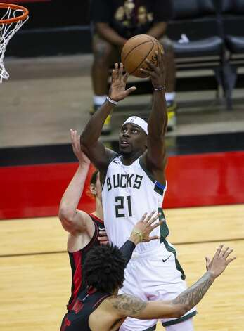 Milwaukee Bucks guard Jrue Holiday (21) shoots over Houston Rockets center Christian Wood (35) during the third quarter of an NBA game between the Houston Rockets and Milwaukee Bucks on Thursday, April 29, 2021, at Toyota Center in Houston. Photo: Mark Mulligan/Staff Photographer / © 2021 Mark Mulligan / Houston Chronicle