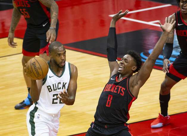 Houston Rockets forward Jae'Sean Tate (8) defends Milwaukee Bucks forward Khris Middleton (22) during the first quarter of an NBA game between the Houston Rockets and Milwaukee Bucks on Thursday, April 29, 2021, at Toyota Center in Houston. Photo: Mark Mulligan/Staff Photographer / © 2021 Mark Mulligan / Houston Chronicle