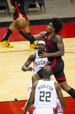 Houston Rockets guard Kevin Porter Jr. (3) shoots during the first quarter of an NBA game between the Houston Rockets and Milwaukee Bucks on Thursday, April 29, 2021, at Toyota Center in Houston. Photo: Mark Mulligan/Staff Photographer / © 2021 Mark Mulligan / Houston Chronicle