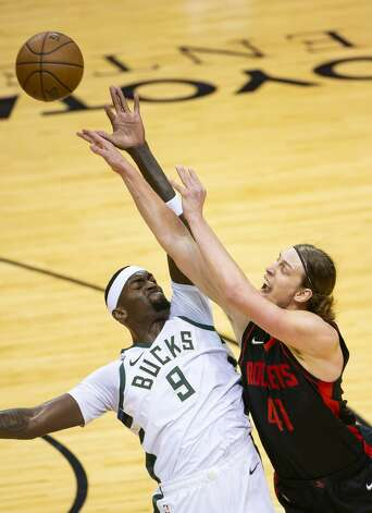 Houston Rockets forward Kelly Olynyk (41) is fouled by Milwaukee Bucks center Bobby Portis (9) during the first quarter of an NBA game between the Houston Rockets and Milwaukee Bucks on Thursday, April 29, 2021, at Toyota Center in Houston. Photo: Mark Mulligan/Staff Photographer / © 2021 Mark Mulligan / Houston Chronicle