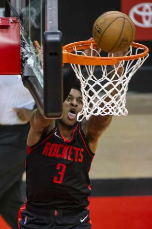 Houston Rockets guard Kevin Porter Jr. (3) dunks during the first quarter of an NBA game between the Houston Rockets and Milwaukee Bucks on Thursday, April 29, 2021, at Toyota Center in Houston. Photo: Mark Mulligan/Staff Photographer / © 2021 Mark Mulligan / Houston Chronicle