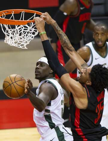 Houston Rockets center Christian Wood (35) dunks over Milwaukee Bucks guard Jrue Holiday (21) during the first quarter of an NBA game between the Houston Rockets and Milwaukee Bucks on Thursday, April 29, 2021, at Toyota Center in Houston. Photo: Mark Mulligan/Staff Photographer / © 2021 Mark Mulligan / Houston Chronicle