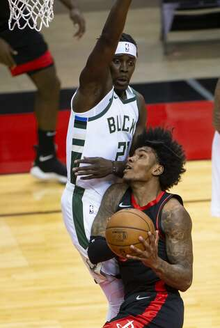 Houston Rockets guard Kevin Porter Jr. (3) drives defended by Milwaukee Bucks guard Jrue Holiday (21) during the first quarter of an NBA game between the Houston Rockets and Milwaukee Bucks on Thursday, April 29, 2021, at Toyota Center in Houston. Photo: Mark Mulligan/Staff Photographer / © 2021 Mark Mulligan / Houston Chronicle