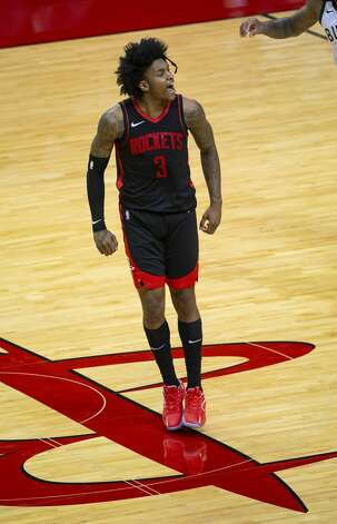 Houston Rockets guard Kevin Porter Jr. (3) reacts after hitting a 3-point shot during the third quarter of an NBA game between the Houston Rockets and Milwaukee Bucks on Thursday, April 29, 2021, at Toyota Center in Houston. Photo: Mark Mulligan/Staff Photographer / © 2021 Mark Mulligan / Houston Chronicle