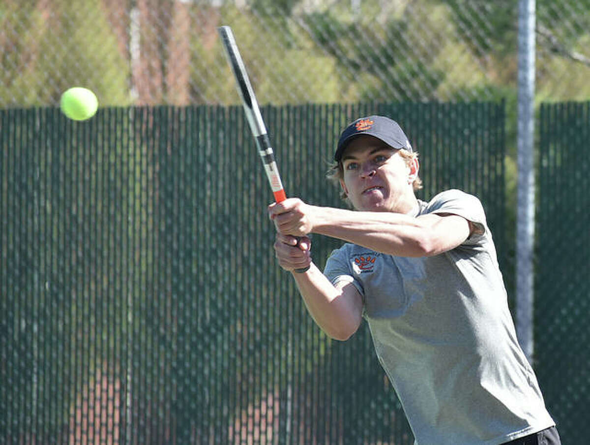 In this file photo from April 13, Edwardsville's Ben Blake connects for a shot in his doubles match against Belleville East inside the EHS Tennis Center. Thursday at O'Fallon, Blake won at No. 8 singles and teamed with Sam Motley for a victory at No. 4 doubles.