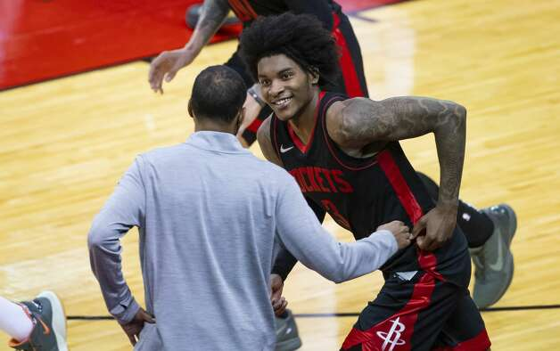 Houston Rockets guard Kevin Porter Jr. (3) smiles at Houston Rockets head coach Stephen Silas as he runs back down court after hitting another 3-point shot during the fourth quarter of an NBA game between the Houston Rockets and Milwaukee Bucks on Thursday, April 29, 2021, at Toyota Center in Houston. Porter Jr. scored a career-high 50 points during the Rockets' 143-136 win over the Milwaukee Bucks. Photo: Mark Mulligan/Staff Photographer / © 2021 Mark Mulligan / Houston Chronicle