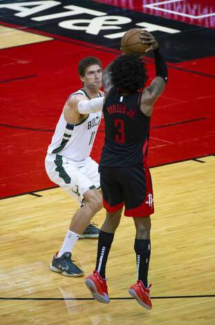 Houston Rockets guard Kevin Porter Jr. (3) hits a 3-point shot over Milwaukee Bucks center Brook Lopez (11) during the fourth quarter of an NBA game between the Houston Rockets and Milwaukee Bucks on Thursday, April 29, 2021, at Toyota Center in Houston. Porter Jr. scored a career-high 50 points during the Rockets' 143-136 win over the Milwaukee Bucks. Photo: Mark Mulligan/Staff Photographer / © 2021 Mark Mulligan / Houston Chronicle