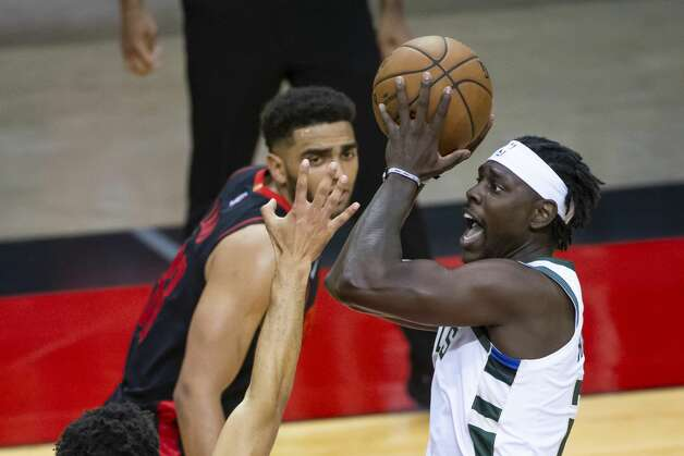 Milwaukee Bucks guard Jrue Holiday (21) shoots during the fourth quarter of an NBA game between the Houston Rockets and Milwaukee Bucks on Thursday, April 29, 2021, at Toyota Center in Houston. Photo: Mark Mulligan/Staff Photographer / © 2021 Mark Mulligan / Houston Chronicle