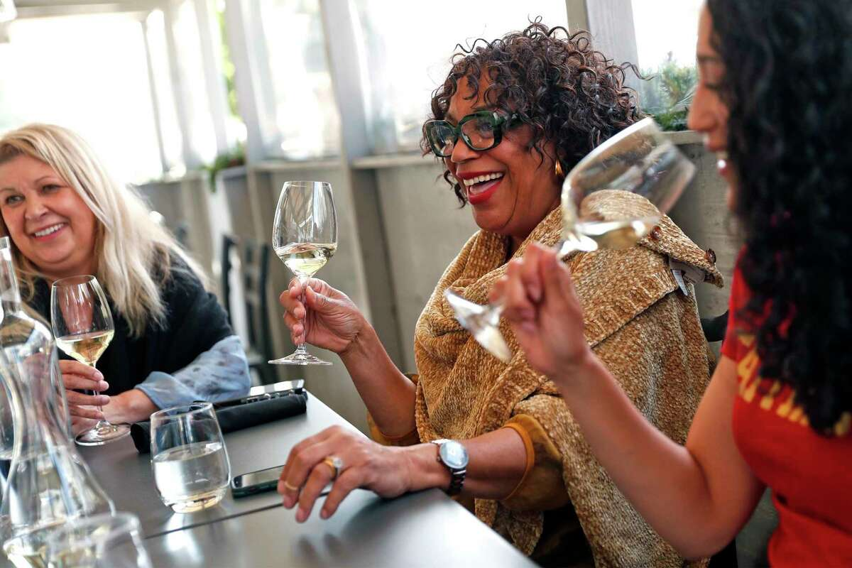 Katia Flitnar (left), Deborah Cali and Caycee Cali dine at Cultivar on Chestnut Street in San Francisco. The city is on track to gain entry to the yellow tier of California's pandemic restrictions.
