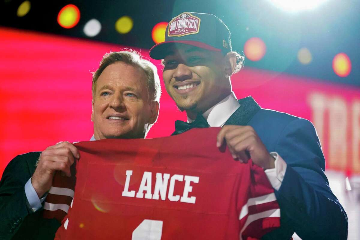 North Dakota State quarterback Trey Lance, right, holds a jersey with NFL Commissioner Roger Goodell after being chosen by the San Francisco 49ers with the third pick.