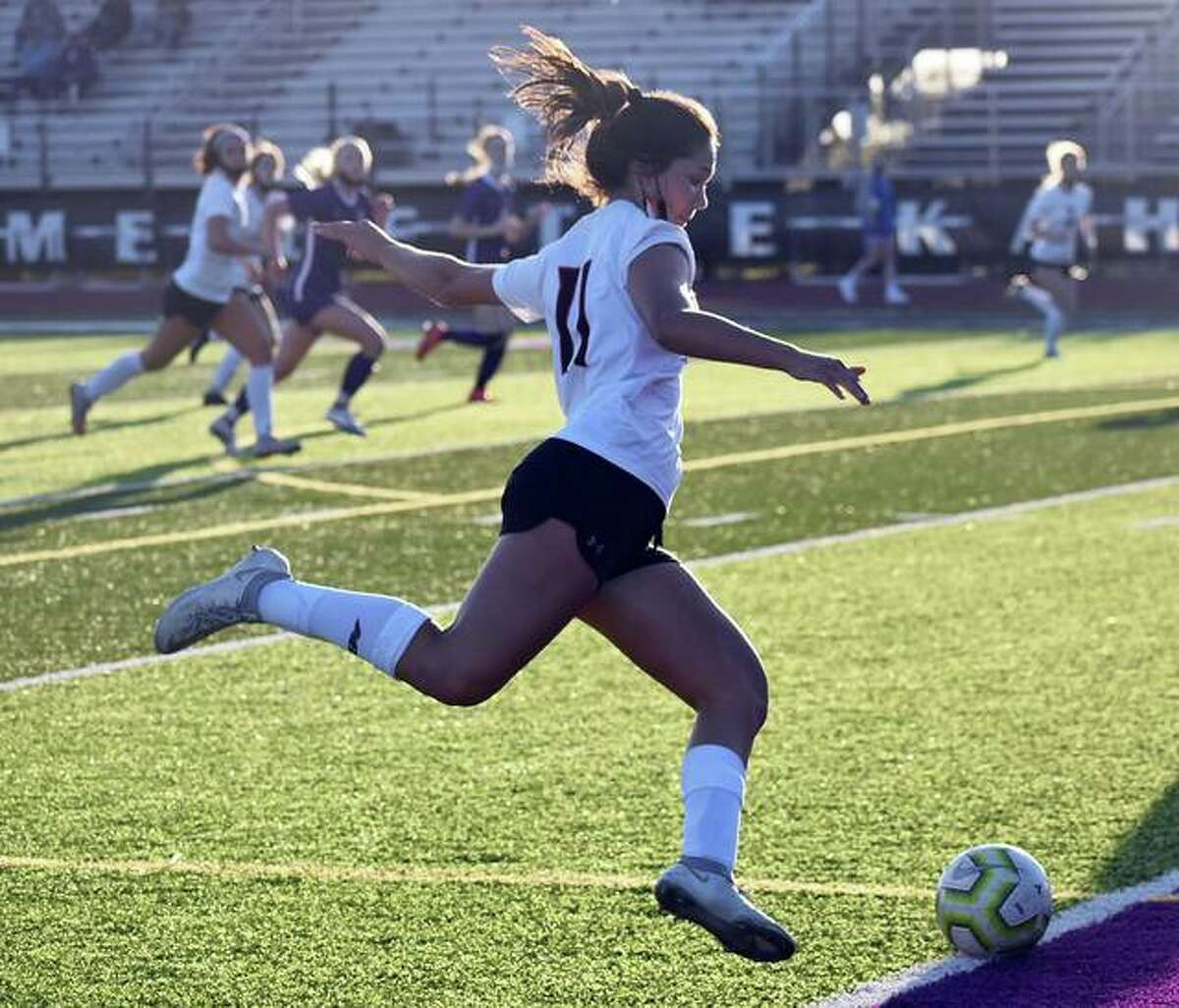Edwardsville's Olivia Baca drills a shot just wide of the goal in the first half against Collinsville on Thursday in Collinsville.