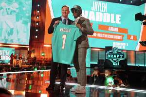 CLEVELAND, OHIO - APRIL 29: Jaylen Waddle poses with NFL Commissioner Roger Goodell onstage after being selected with the sixth pick by the Miami Dolphins during round one of the 2021 NFL Draft at the Great Lakes Science Center on April 29, 2021 in Cleveland, Ohio.