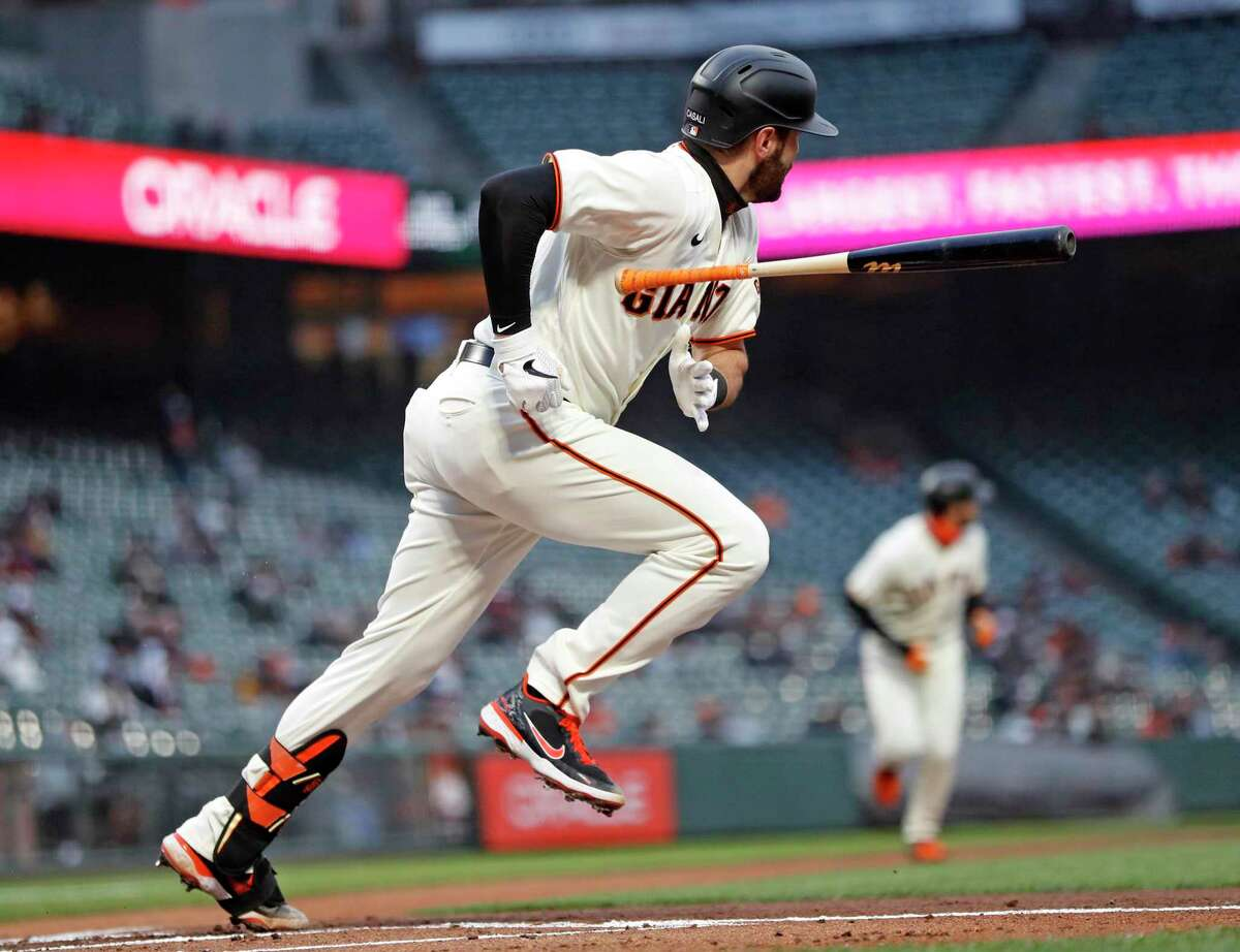 San Francisco Giants' Curt Casali throws his bat after hitting 2-run single against Miami Marlins during 1st inning of MLB game at Oracle Park in San Francisco, Calif., on Thursday, April 22, 2021.