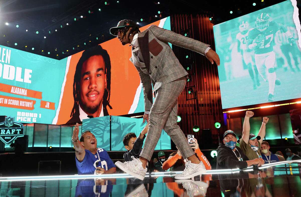 Jaylen Waddle strolls onstage after the Miami Dolphins drafted the former Alabama star wide receiver with the sixth overall pick.