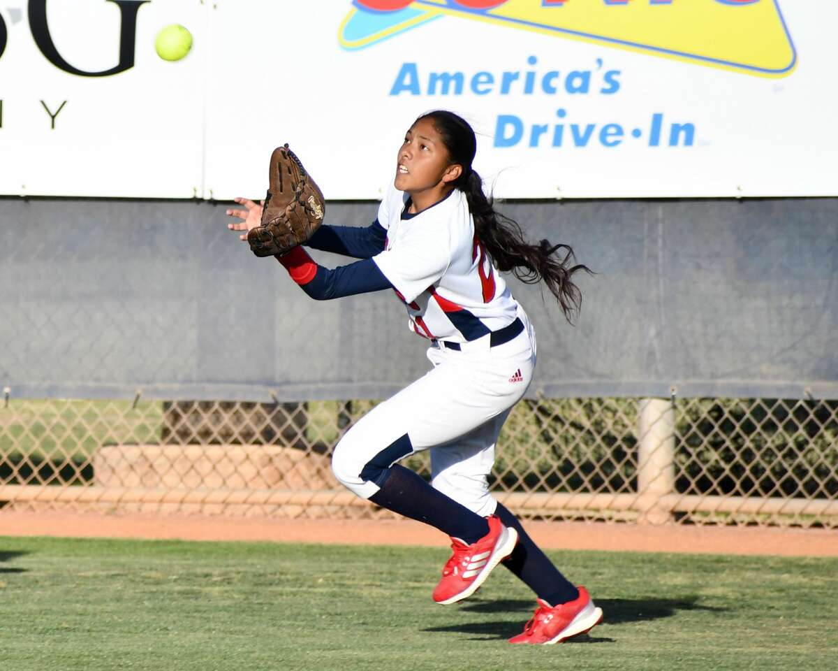 Plainview's Gabby Alvarez tries to corral a fly ball during a Class 5A UIL bi-district softball playoff game against Lubbock Monterey on Thursday at Lady Bulldog Park.