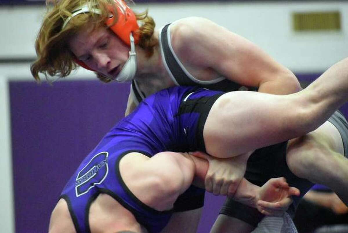Edwardsville's Jackson Summers gets a first-round takedown in his match at 126 pounds against Collinsville on Thursday inside Vergil Fletcher Gymnasium.