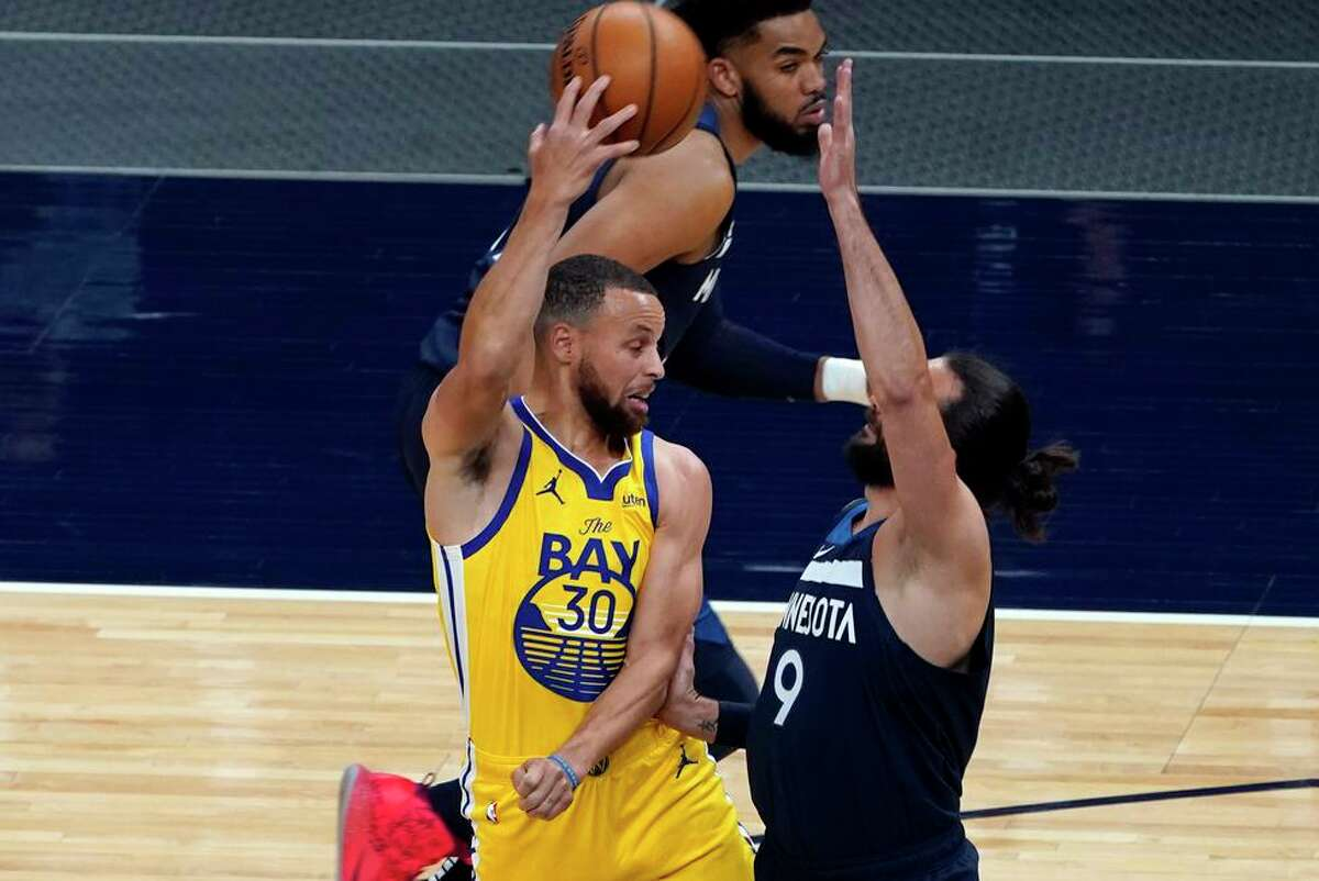 Golden State's Stephen Curry passes around Minnesota's Ricky Rubio in the first half. Curry scored 37 in the loss.