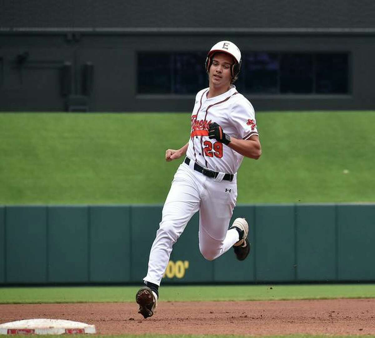 In this file photo, Edwardsville's Spencer Stearns strolls into third base with a stand-up triple during a game against Triad at Busch Stadium. On Thursday against O'Fallon, Stearns drove in a career-high five runs.