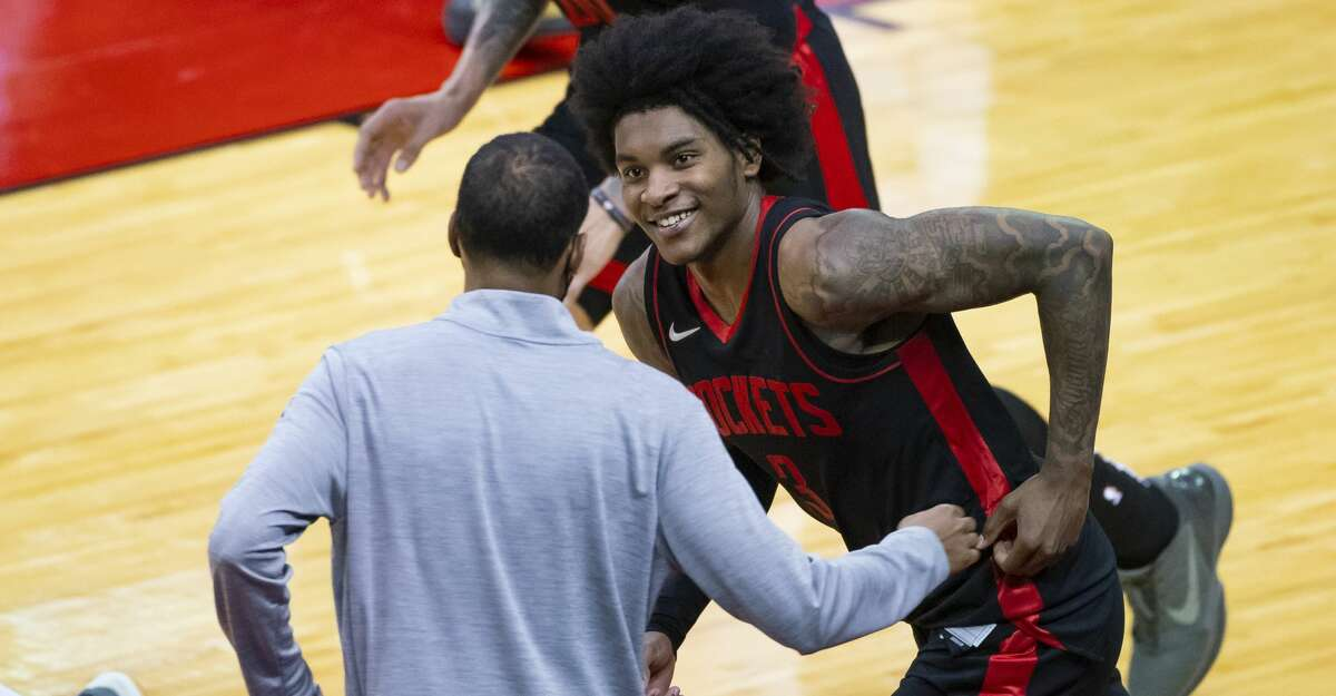 Houston Rockets guard Kevin Porter Jr. (3) smiles at Houston Rockets head coach Stephen Silas as he runs back down court after hitting another 3-point shot during the fourth quarter of an NBA game between the Houston Rockets and Milwaukee Bucks on Thursday, April 29, 2021, at Toyota Center in Houston. Porter Jr. scored a career-high 50 points during the Rockets' 143-136 win over the Milwaukee Bucks.