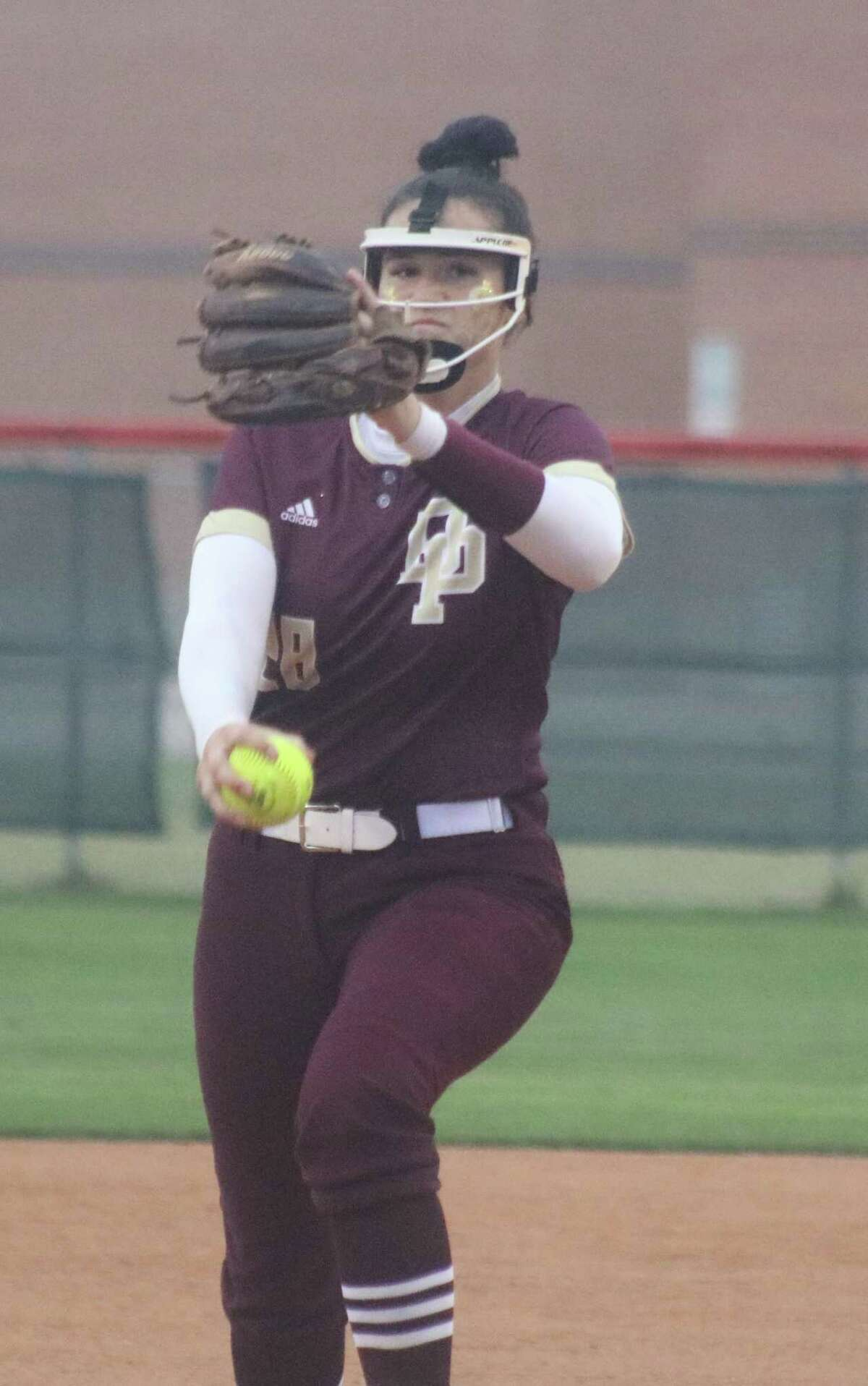 Deer Park's Madison Applebe works on a North Shore batter Thursday night, en route to her four-hitter.that nailed down the bi-district title.