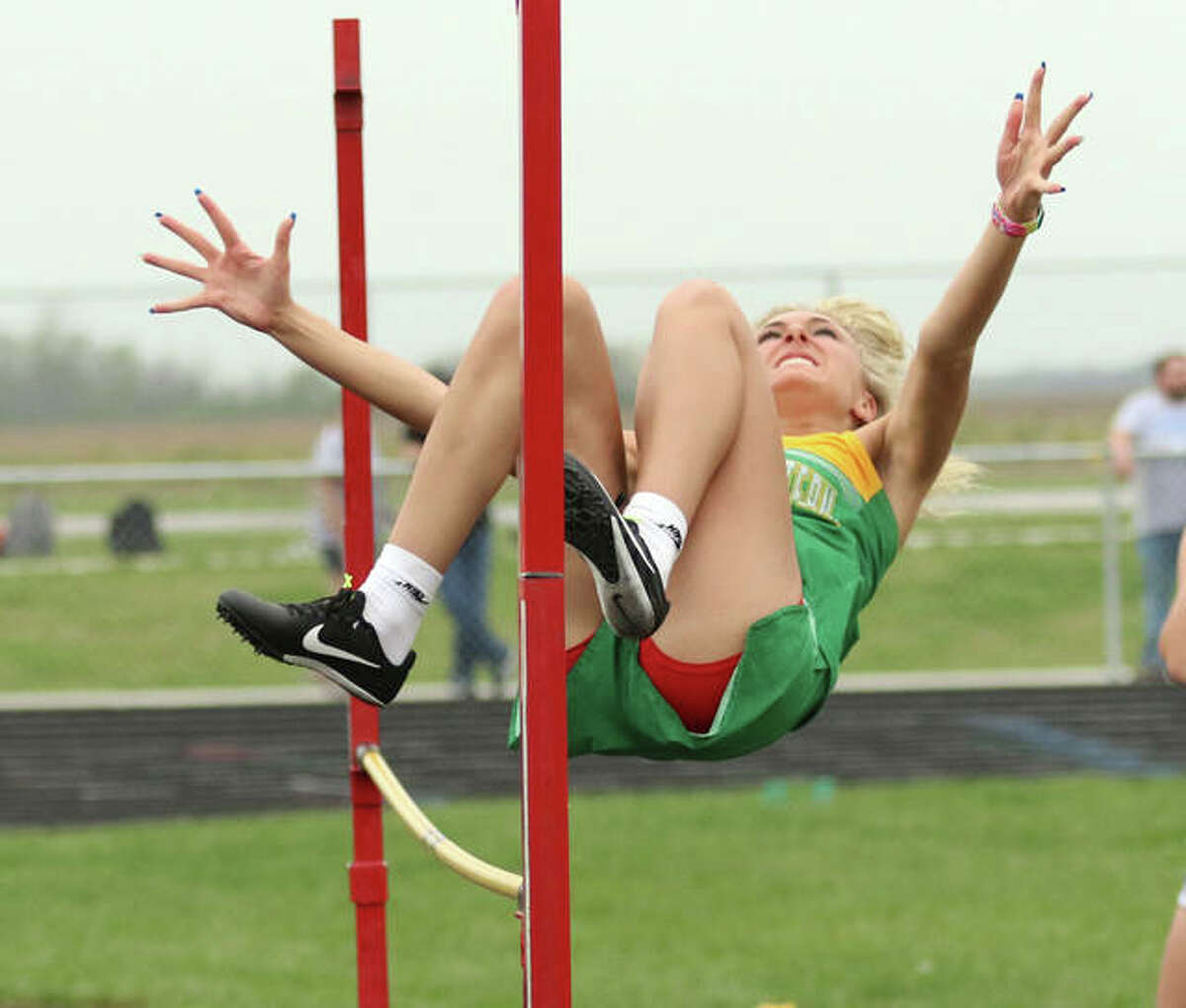 Southwestern's Morgan Dunham, shown clearing the bar in the high jump Tuesday at the Bert Trump Relays at Southwestern, was back on her home track Thursday and won the high jump at 4-2 in the Piasa Birds' girls and boys sweep of a three-team meet in Piasa.