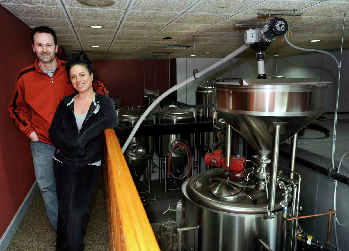 File photo. Rick Cipriani and Wendy Wulkanare seen here in 2014 as co-owners of the former Bull and Barrel Brewery and Restaurant in Brewster, N.Y., which closed in December. Cipriani has proposed a new brewery in Danbury.