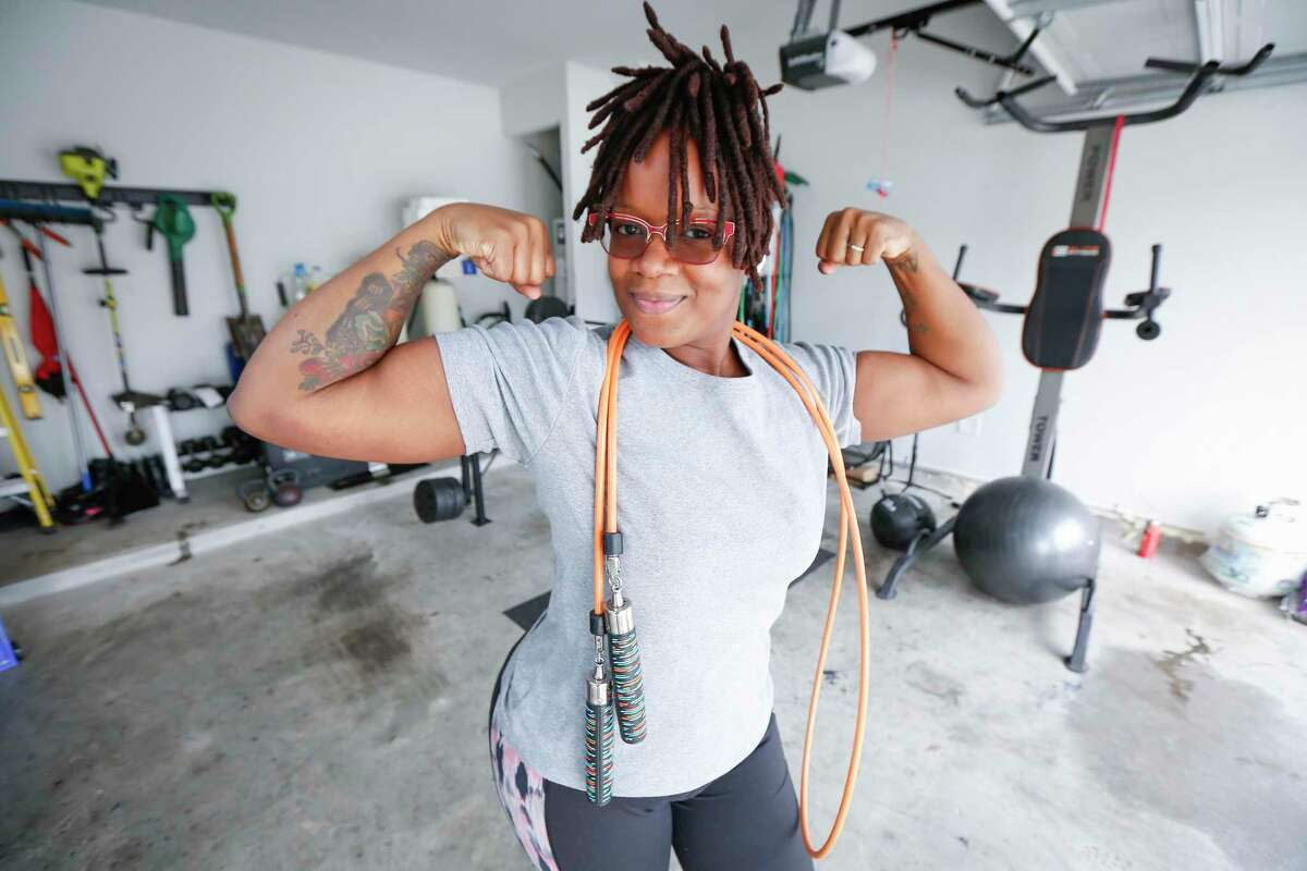 During the pandemic, Brittany Wilson has lost 50 pounds by working out in her garage gym in Humble.