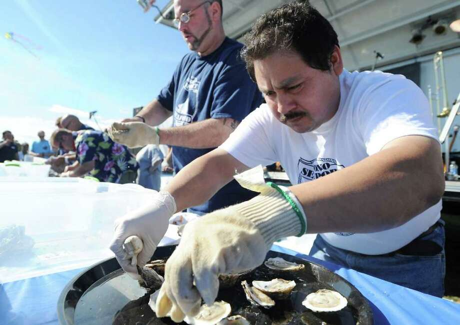 Alfredo Gonzalez, of SoNo Seaport Seafood, participates in the oyster shucking contest at the Annual Norwalk Seaport Association 2010 Oyster Festival at Veteran's Park in Norwalk, Conn. on Saturday September 11, 2010.  Gonzalez won the competition. Photo: Kathleen O'Rourke / Stamford Advocate