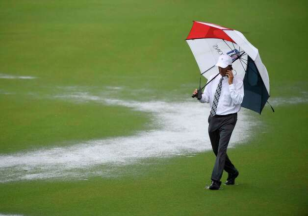 Rules official Brian Claar walks the 18th fairway during a rain delay during the first round of the Insperity Invitational golf tournament, Friday, April 30, 2021, in The Woodlands, TX. Photo: Eric Christian Smith, Contributor