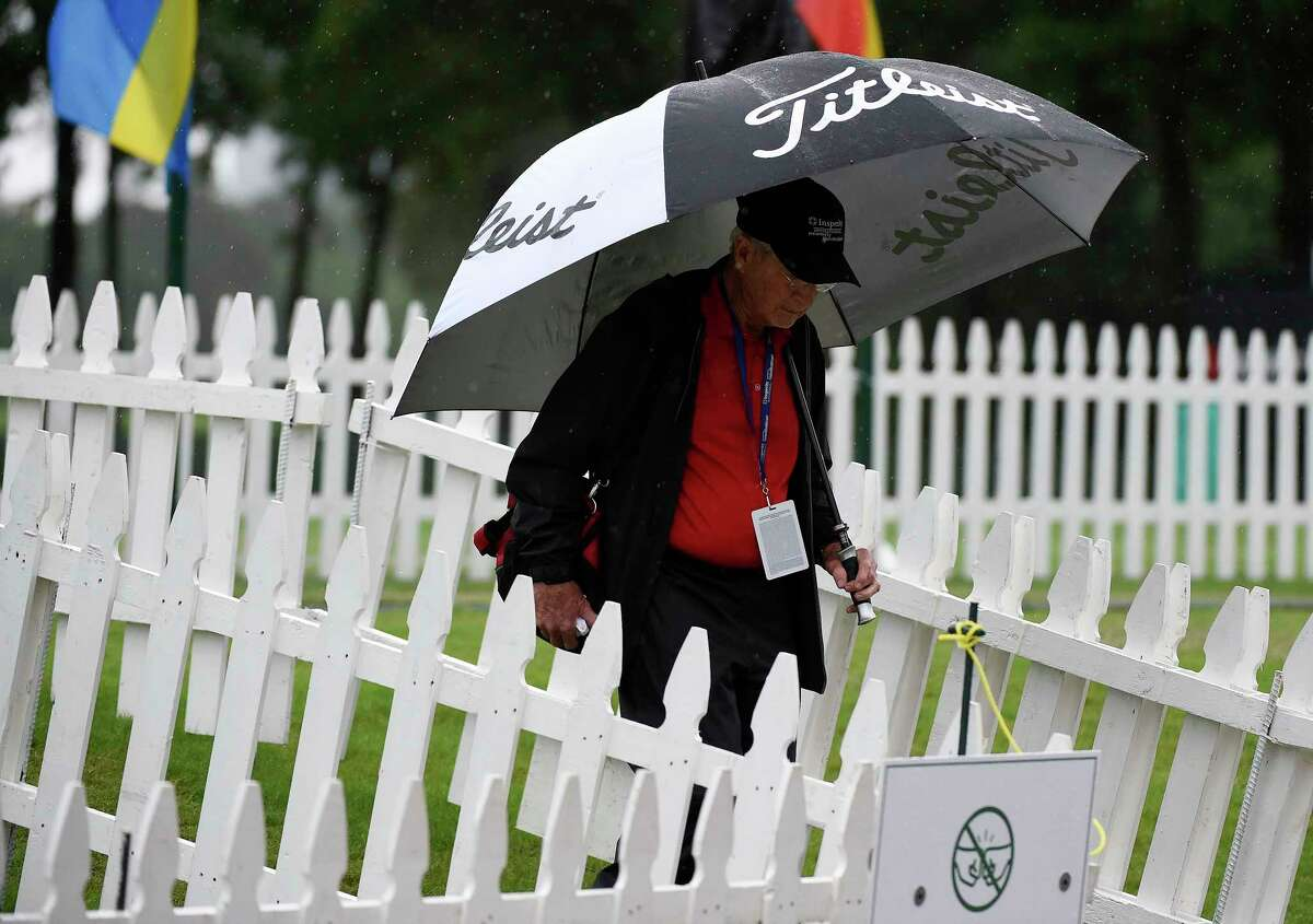 Tournament volunteer Phil Vance walks off the practice tee during a rain delay during the first round of the Insperity Invitational golf tournament, Friday, April 30, 2021, in The Woodlands, TX.