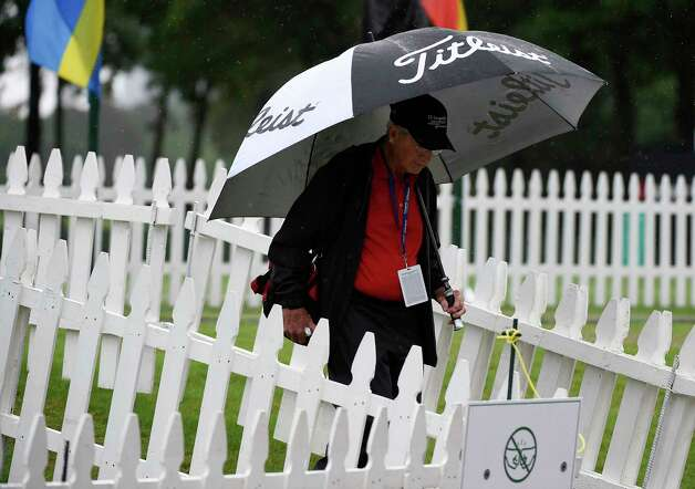 Tournament volunteer Phil Vance walks off the practice tee during a rain delay during the first round of the Insperity Invitational golf tournament, Friday, April 30, 2021, in The Woodlands, TX. Photo: Eric Christian Smith, Contributor