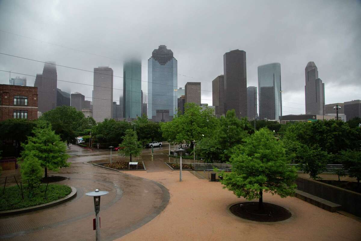 View of Houston's skyline surrounded by fog from the Buffalo Bayou, Friday, April 30, 2021, in Houston.