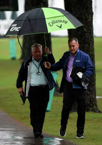 Golf analyst Lanny Wadkins, left, walks near the 18th fairway during the first round of the Insperity Invitational golf tournament, Friday, April 30, 2021, in The Woodlands, TX. Photo: Eric Christian Smith, Contributor