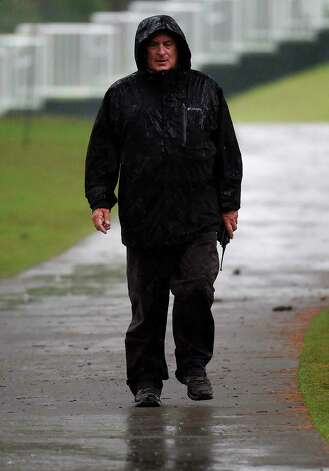 A member of the grounds crew walks near the 18th fairway during a rain delay during the first round of the Insperity Invitational golf tournament, Friday, April 30, 2021, in The Woodlands, TX. Photo: Eric Christian Smith, Contributor
