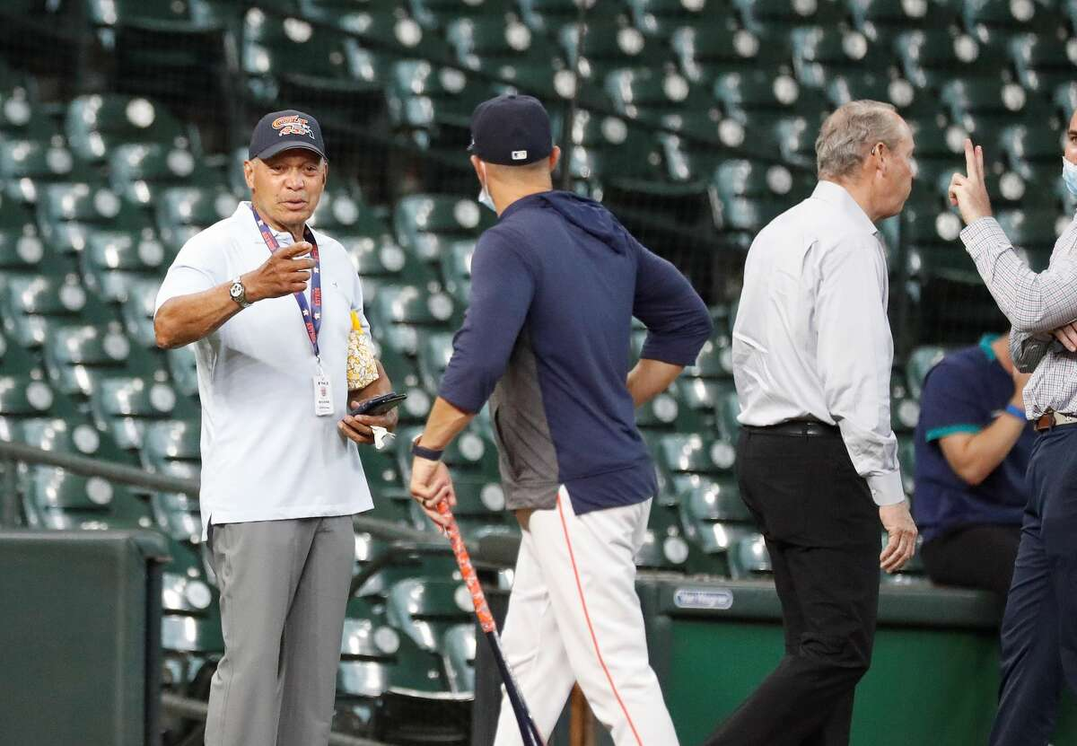 Reggie Jackson talks with Houston Astros bench coach Joe Espada during batting practice before the start of an MLB baseball game at Minute Maid Park, Wednesday, April 28, 2021, in Houston.